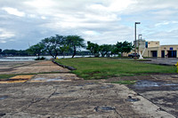 Site on Ford Island (the island in the middle of Pearl Harbor) where the first bomb fell during the attack on Pearl Harbor. The plane came from over those trees and the bomb stuck at the edge of the g